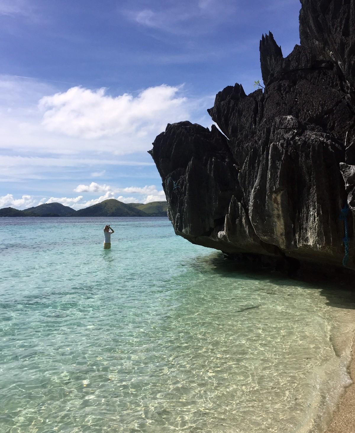 Andrei take a photos on Banol beach, Palawan - Travelblogstories