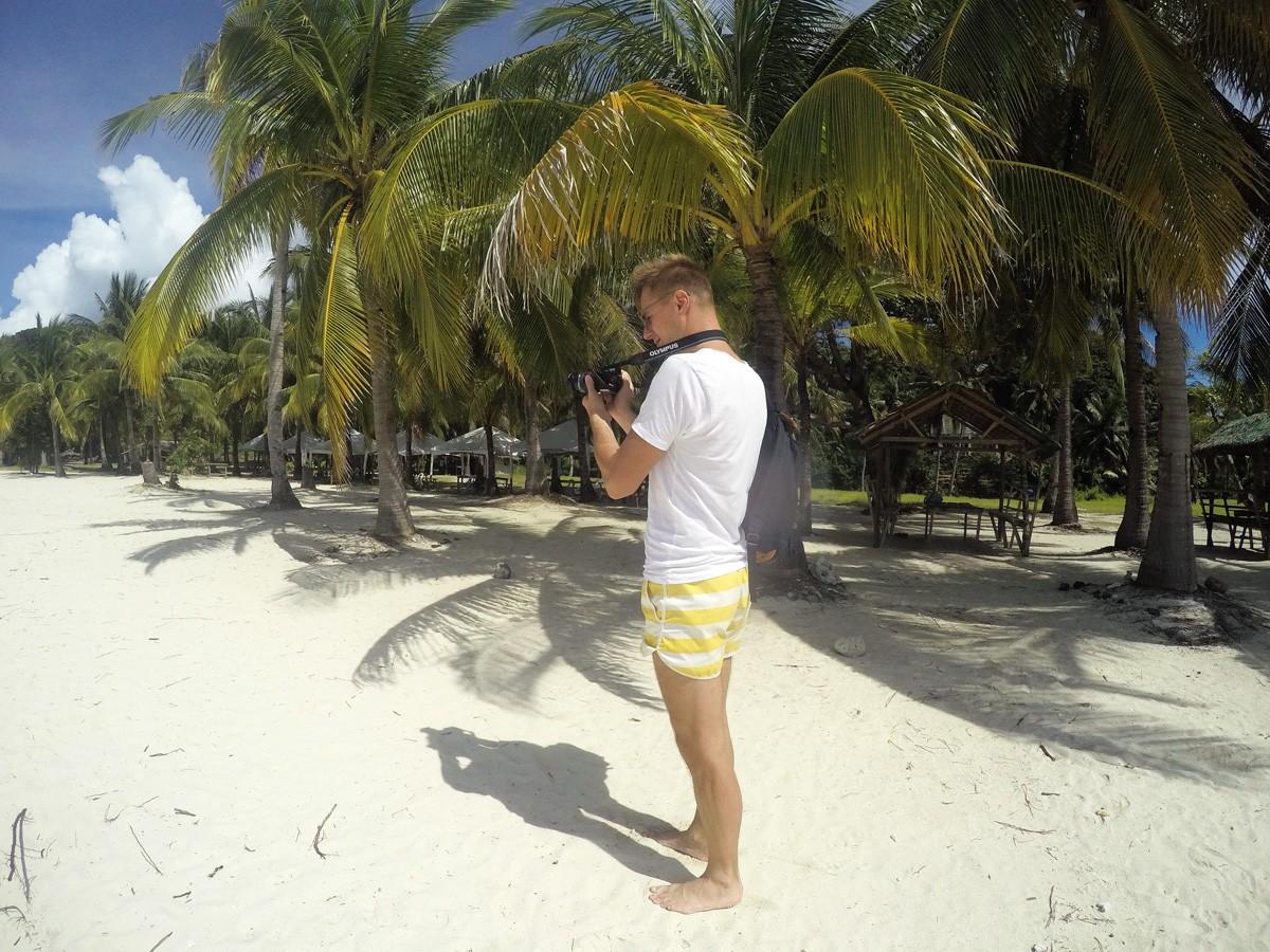 Andrei on Malcapuya island - Travelblogstories