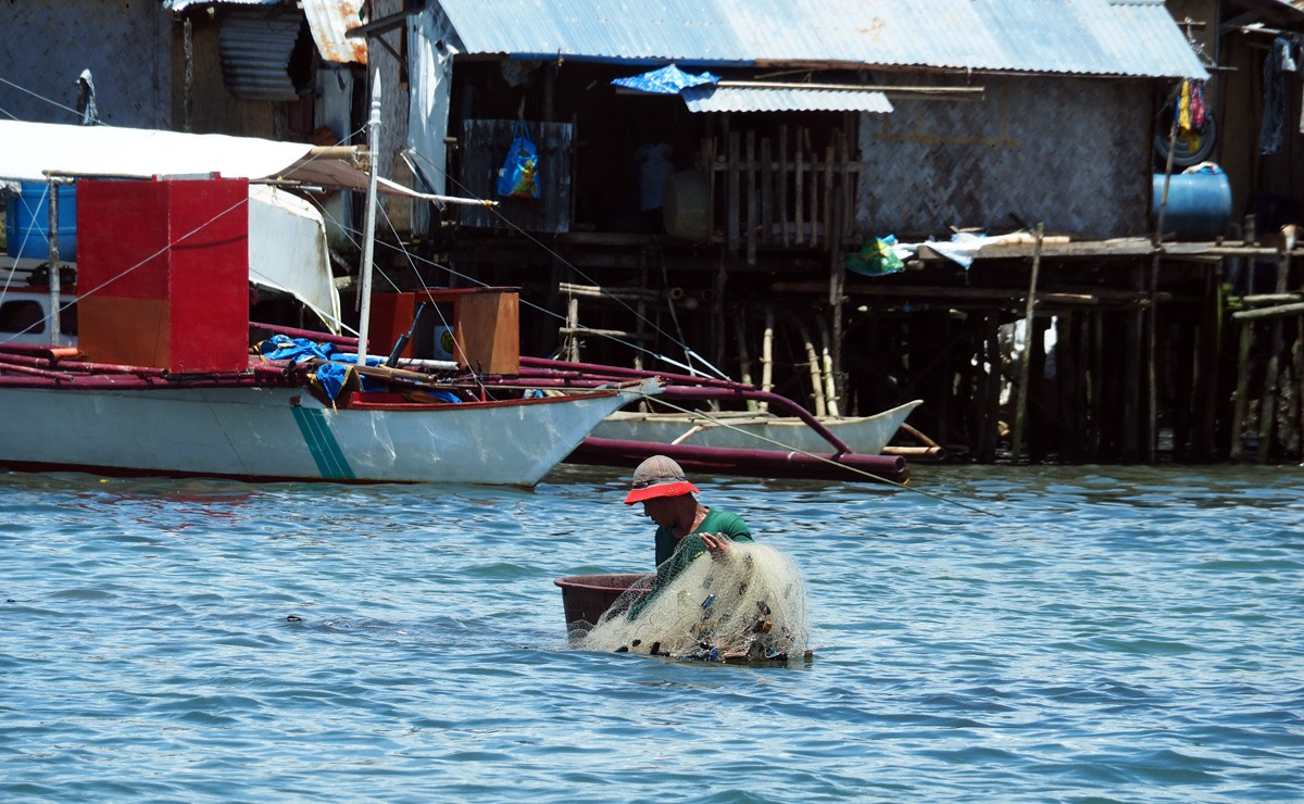 Philippines fisherman on Coron Town port