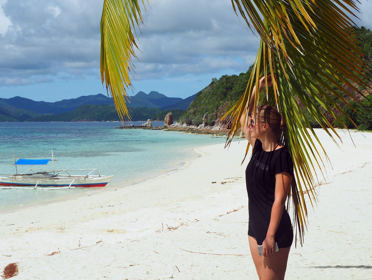 Nastia on Malcapuya island beach - Travelblogstories