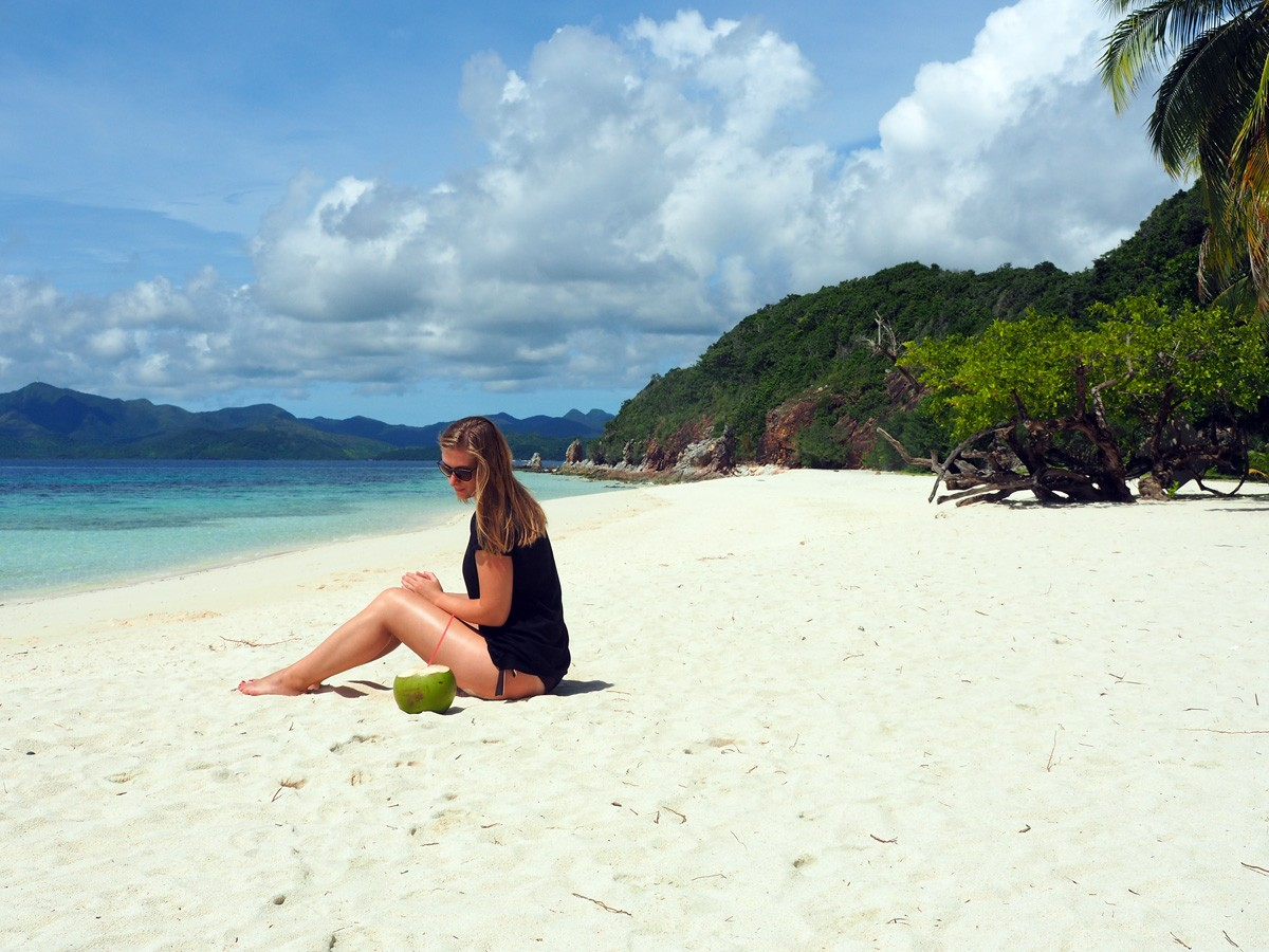 Nastia with coco on Malcapuya island - Travelblogstories