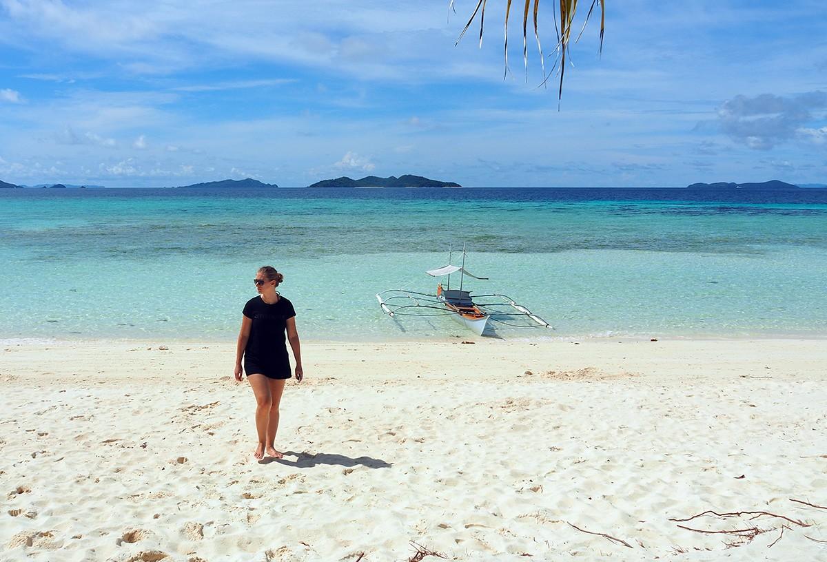Nastya walking on Malcapuya island beach