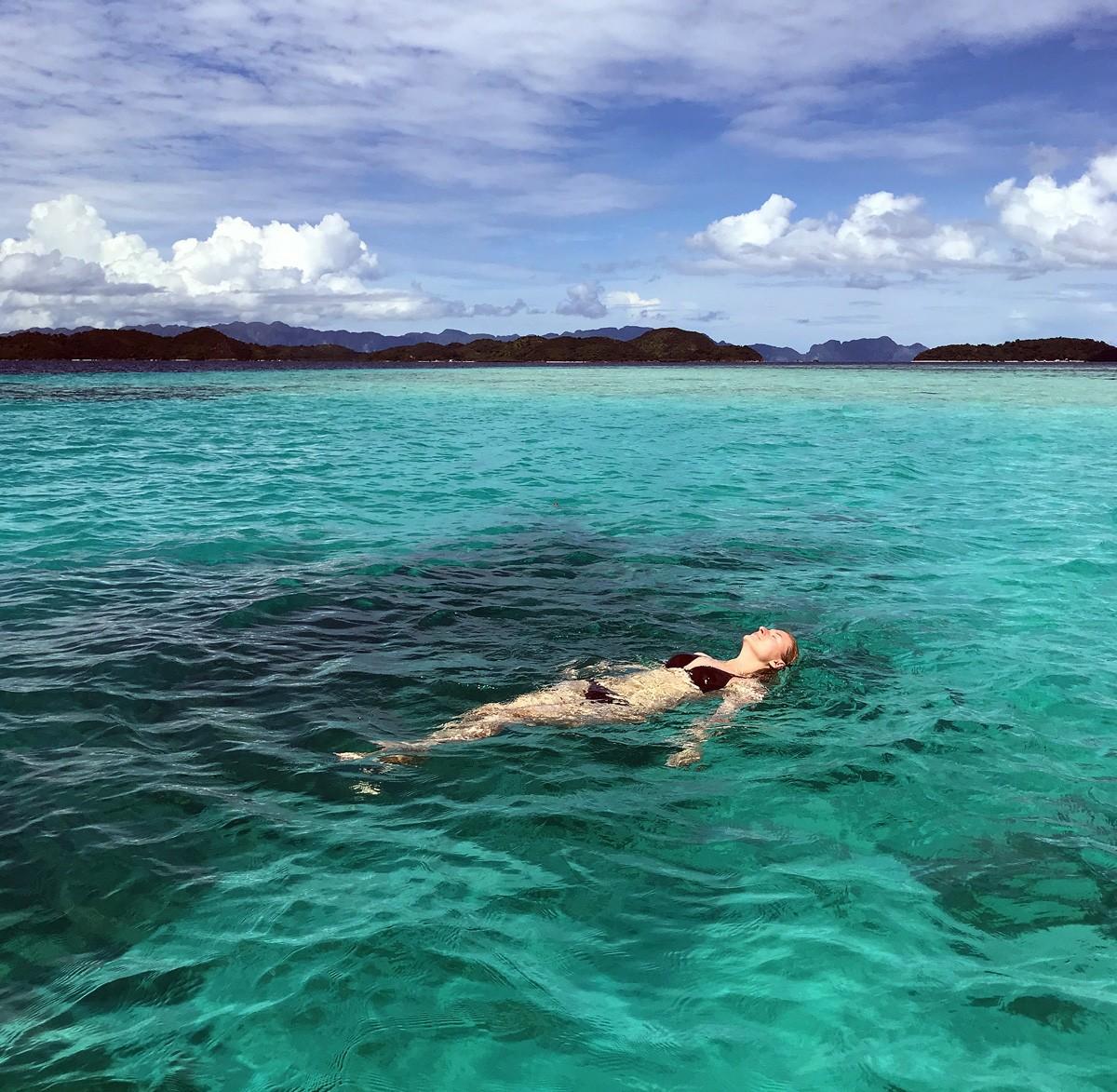 Nastia swim in the open sea, Palawan - Travelblogstories