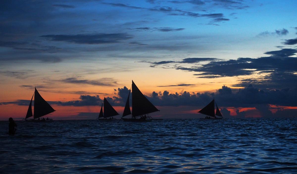boracay_tropical sunset_sail_boats_silhouettes
